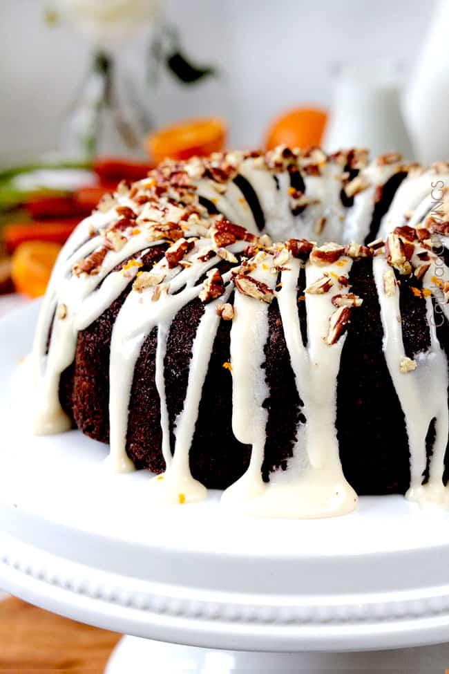 glazed carrot bundt cake on a white cake stand