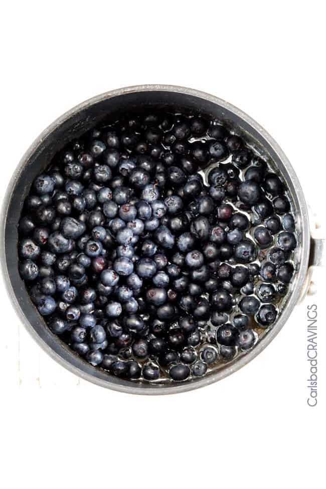 showing how to make best blueberry sauce by adding blueberries, sugar, cornstarch, orange juice and lemon juice to a saucepan