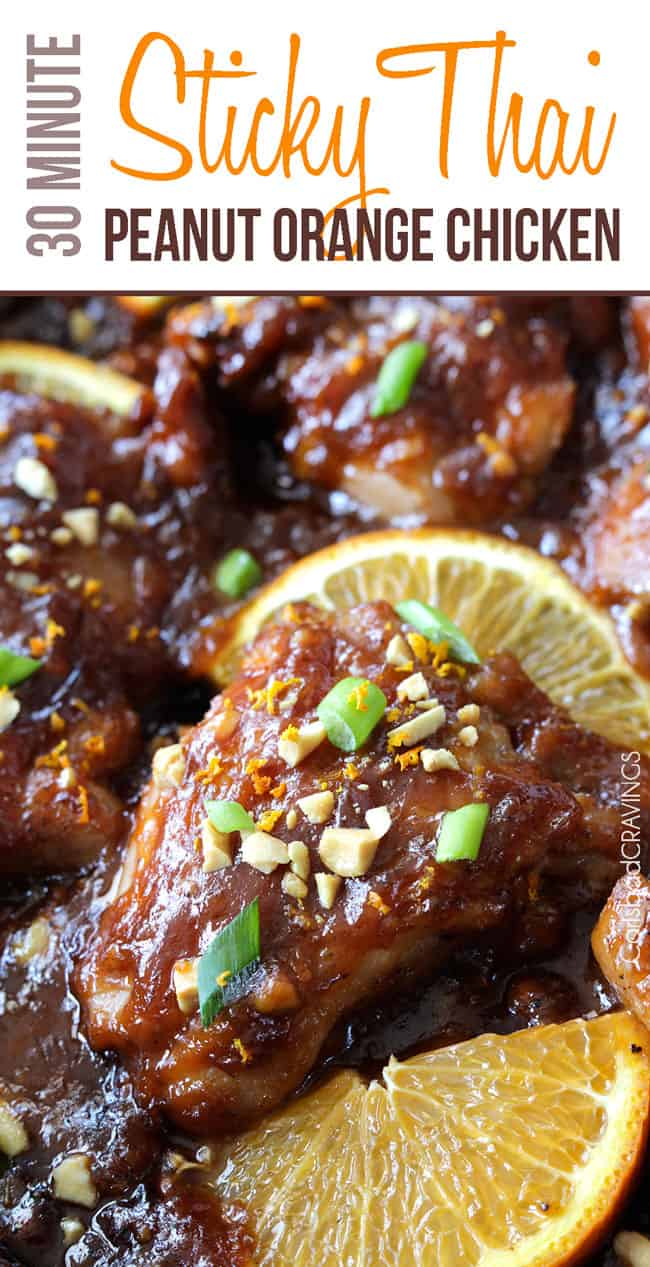 Sticky Thai Peanut Orange Chicken with two slices of lemon.