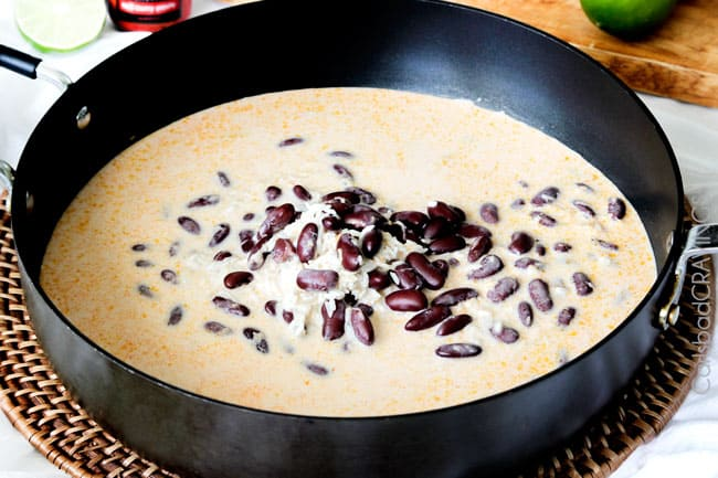 Showing how to make Red Beans and Rice by cooking beans in a black sauce pan.