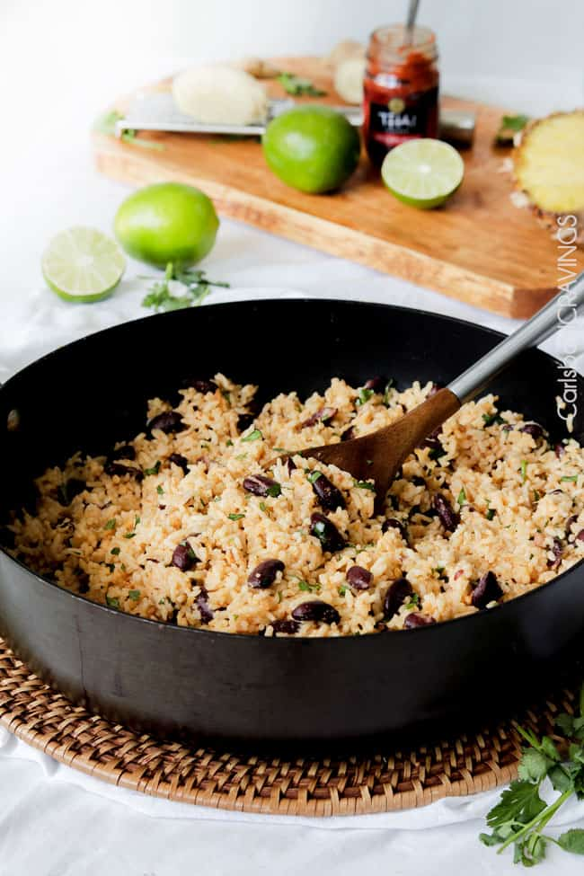 Showing how to make easy Red Beans and Rice mixing rice and beans withs lime on the side.