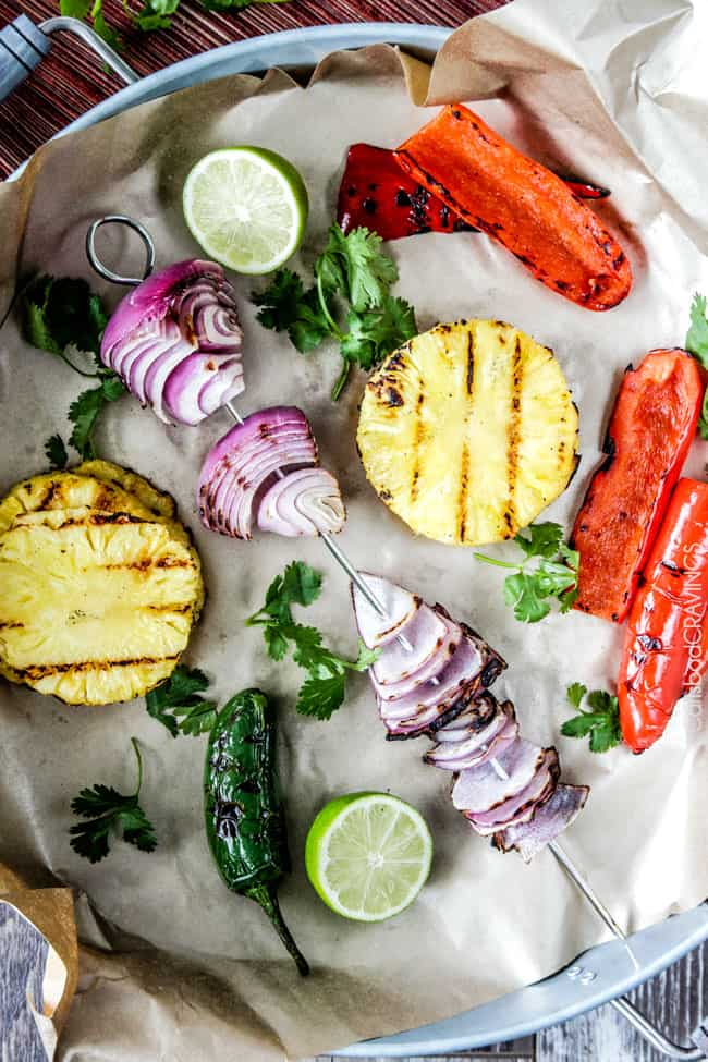 Showing how to make Pineapple Salsa by grilling fruit and vegetables for the salsa.
