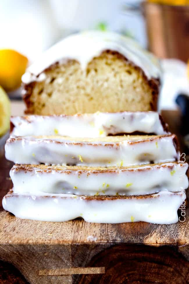 front view of easy Lemon Loaf Cake (Lemon Bread) sliced into thick slices
