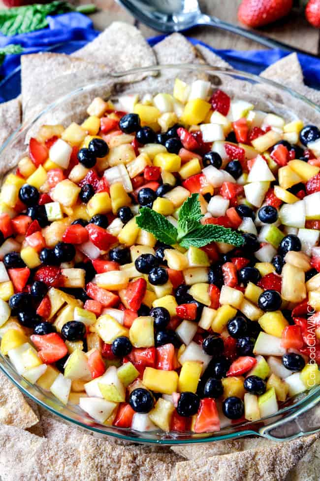 Light and refreshing Rainbow Fruit Salsa (No Bake) Cheesecake Dip is the perfect make ahead dessert/appetizer that no one will be able to stop munching! #cheesecakedip #cheesecake #dip #appetizer #fruitsalsaLight and refreshing Rainbow Fruit Salsa (No Bake) Cheesecake Dip is the perfect make ahead dessert/appetizer that no one will be able to stop munching! #cheesecakedip #cheesecake #dip #appetizer #fruitsalsa