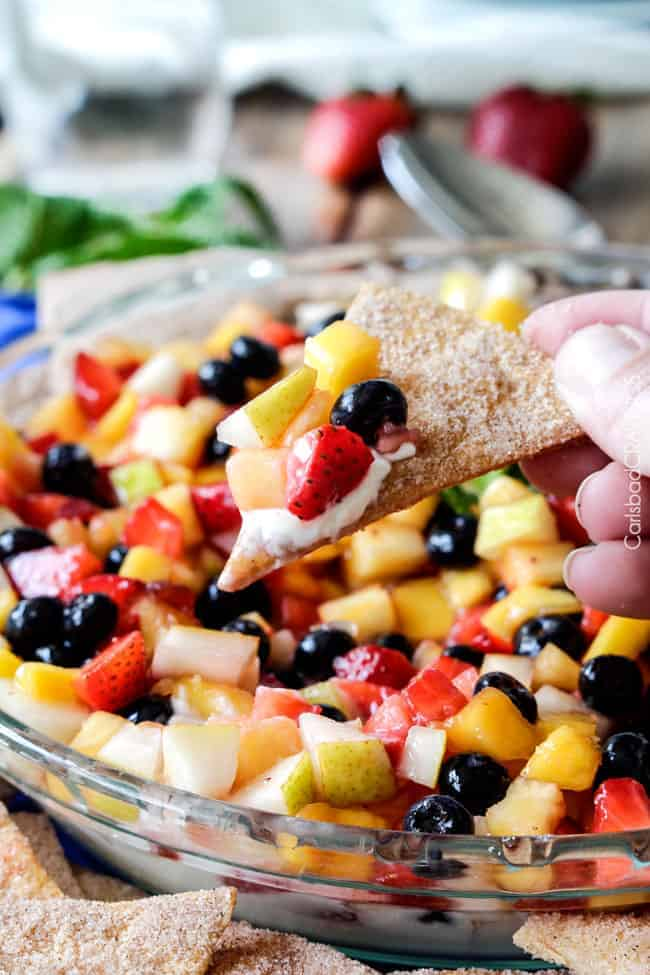 Light and refreshing Rainbow Fruit Salsa (No Bake) Cheesecake Dip is the perfect make ahead dessert/appetizer that no one will be able to stop munching! #cheesecakedip #cheesecake #dip #appetizer #fruitsalsa