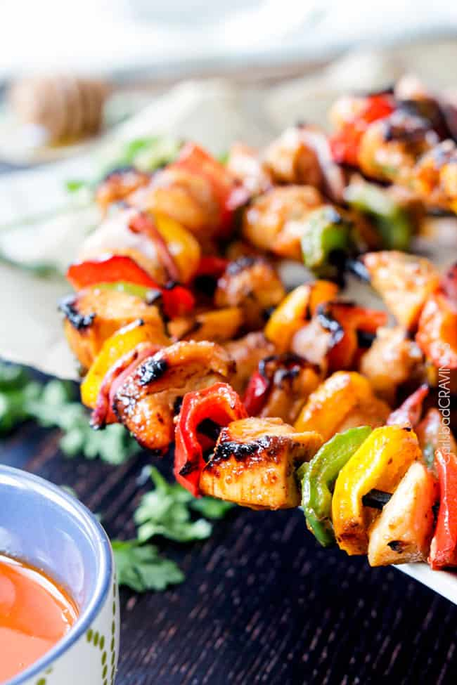 Side view of Honey Buffalo Chicken Fajita Kebabs on skewers.