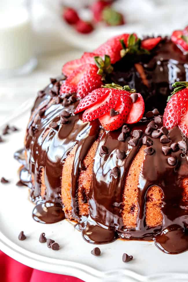 Rich, buttery, tender Strawberry Pound Cake swirled with fresh strawberries and smothered in smooth, silky Chocolate Ganache. 1000X better than any cake mix and so drool worthy everyone will beg you for the recipe! #giveaway #strawberry #strawberrycake #poundcake #summerdessert