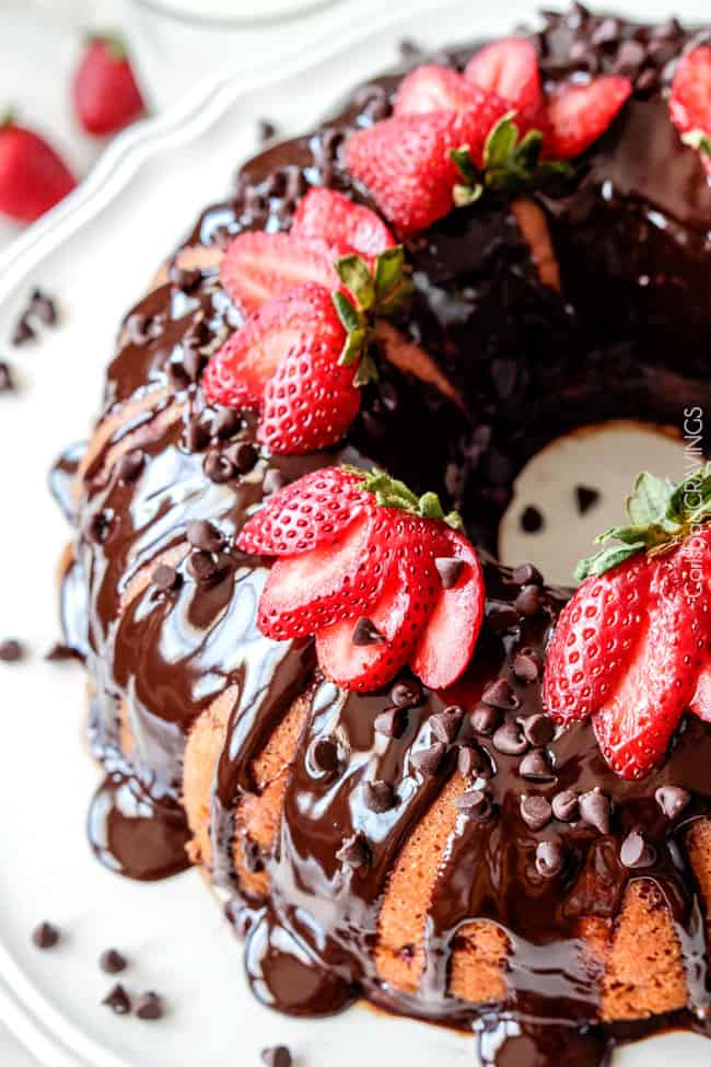 Strawberry Pound Cake drizzled with chocolate and covered with fresh strawberries.
