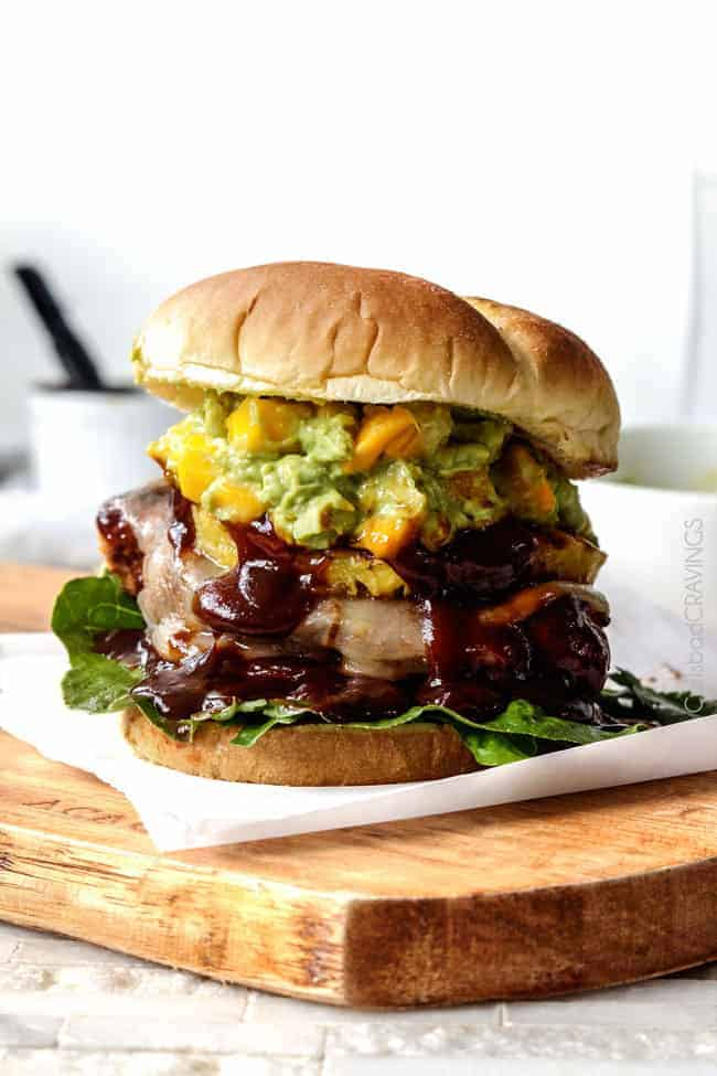 Sweet and Spicy BBQ Chipotle Chicken Sandwiches bathed in melty cheese, topped with grilled pineapple and piled high with Mango Guacamole. AMAZING! #chipotle #chicken #sandwich #guacamole #BBQ