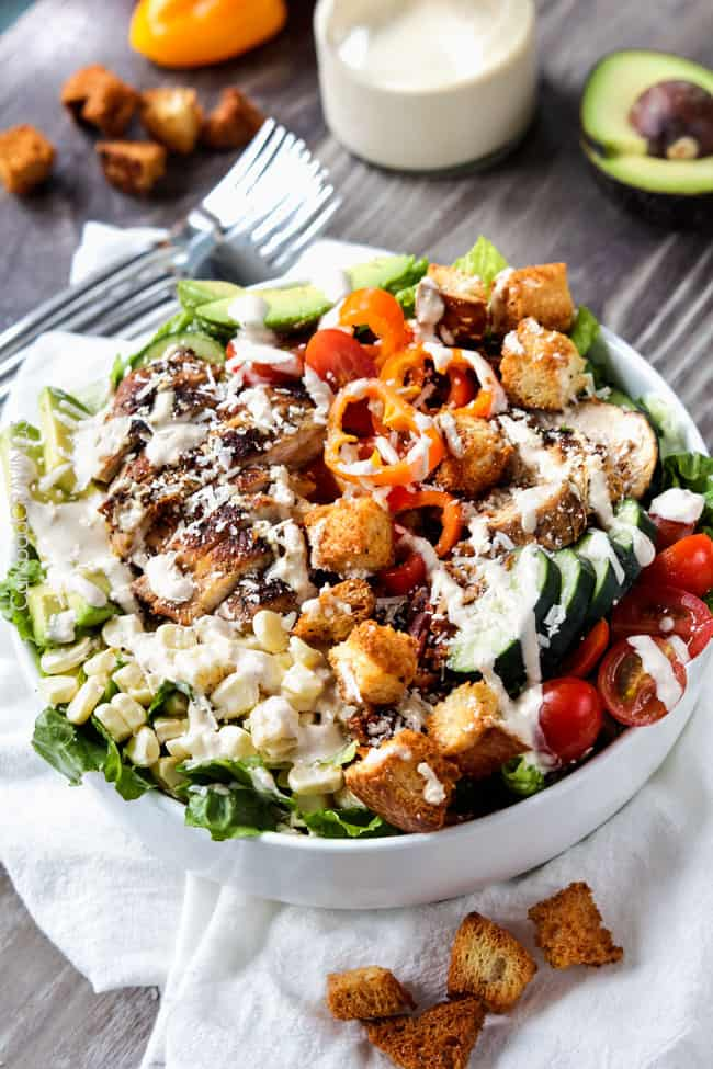 a bowl of easy Chicken Caesar Salad recipe with romaine lettuce, croutons, chicken and Parmesan