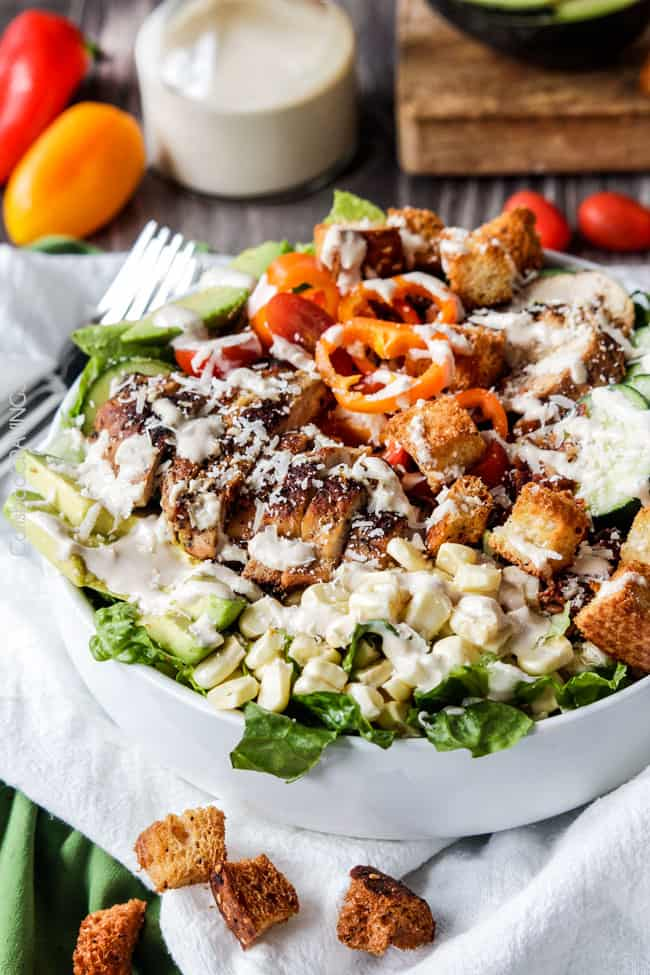 a big bowl of healthy Chicken Caesar Salad with chicken, croutons and Parmesan