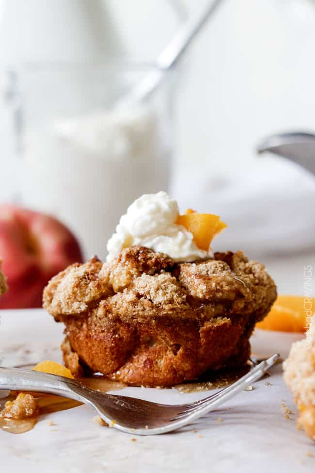 Baked Peaches and Cream French Toast Muffins are an irresistible STRESS FREE make-ahead breakfast bursting with sweet peaches, crowned with Cinnamon Streusel, doused with syrup and topped with luscious cream! !