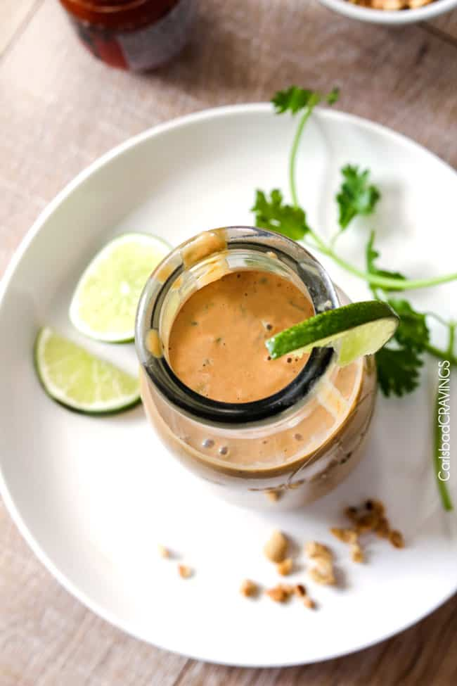 top view of easy thai peanut salad dressing in a glass bottle