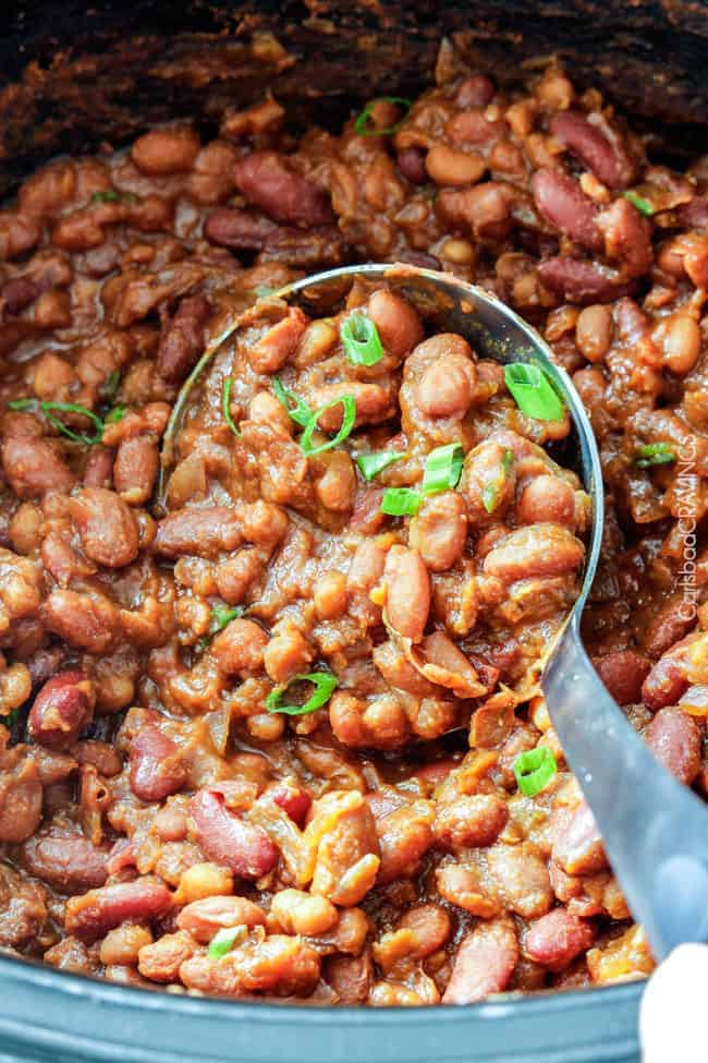 Hawaiian Barbecue Baked Beans with a serving ladle.