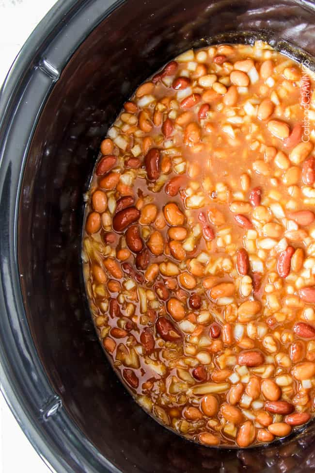 Showing the cooked Crockpot Baked Beans in the slow cooker.
