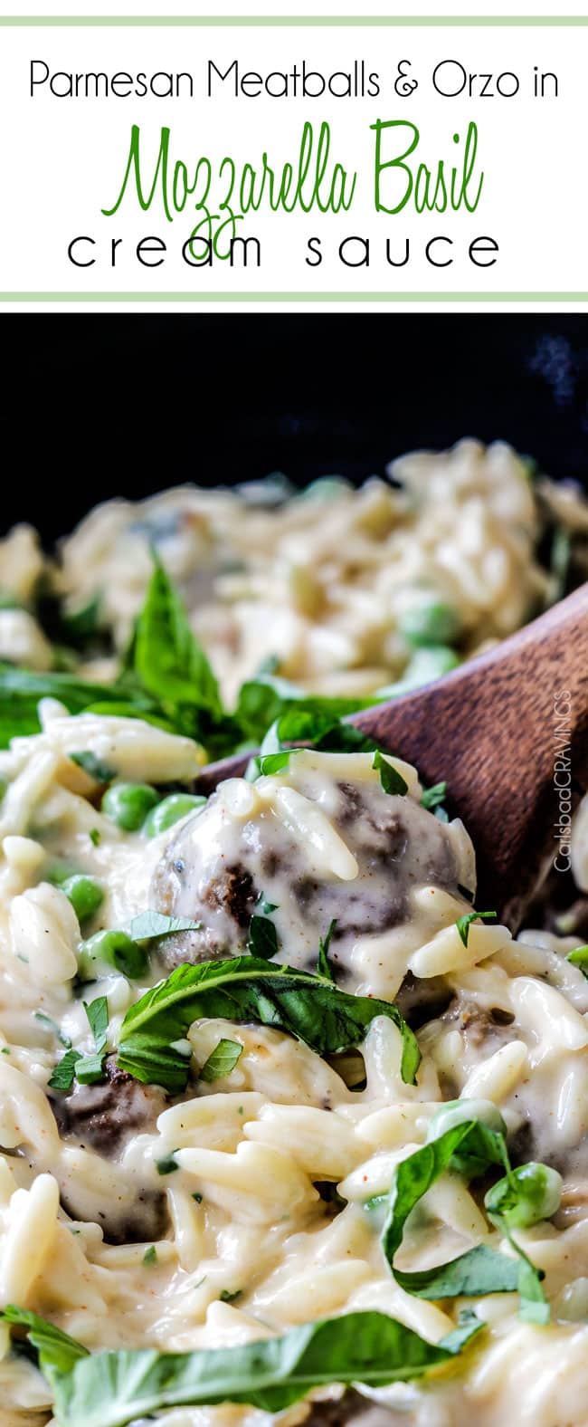 Parmesan Meatballs in a cream sauce with orzo and basil being served with a wood spoon.