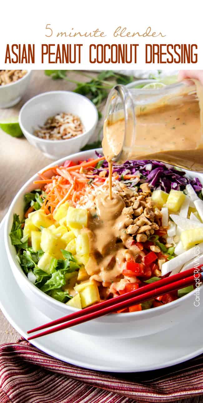 pouring spicy Thai Peanut Dressing over a salad