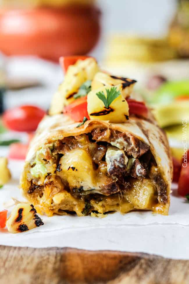 Better than takeout California Carne Asada Burritos stuffed with thinly sliced, tender marinated Carne Asada, cheese, salsa, avocado crema and the best part - Mexican French Fries!!! so easy, great for crowds at a fraction of the cost! #carneasada #burritos #california