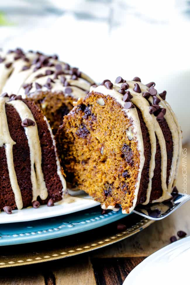 showing how to make Pumpkin Bundt Cake by taking a slice out of the cake
