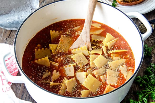 Showing how to make Lasagna Soup adding pasta.