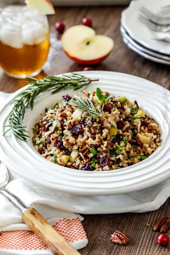 Easy one pot Cranberry Apple Pecan Rice Pilaf simmered in herb seasoned chicken broth and apple juice and riddled with sweet dried cranberries, apples and roasted pecans for an unbelievable savory sweet side dish perfect for the holidays. Everyone always asks for this recipe!