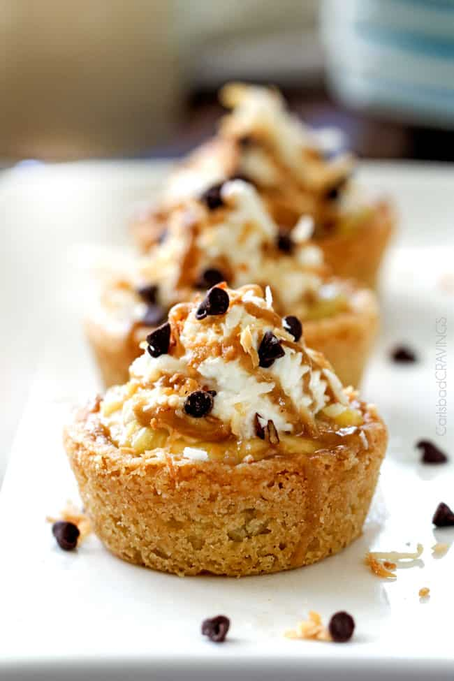 Close up of Mini Banana Coconut Cream Pies with coconut and chocolate chips on top.