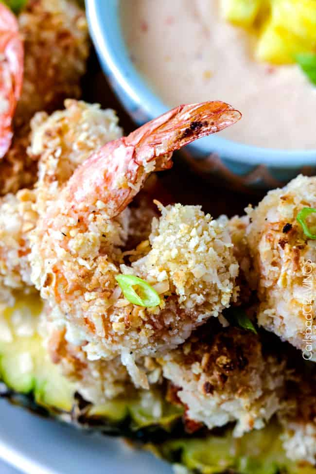 up close of baked coconut shrimp with pineapple coconut shrimp sauce