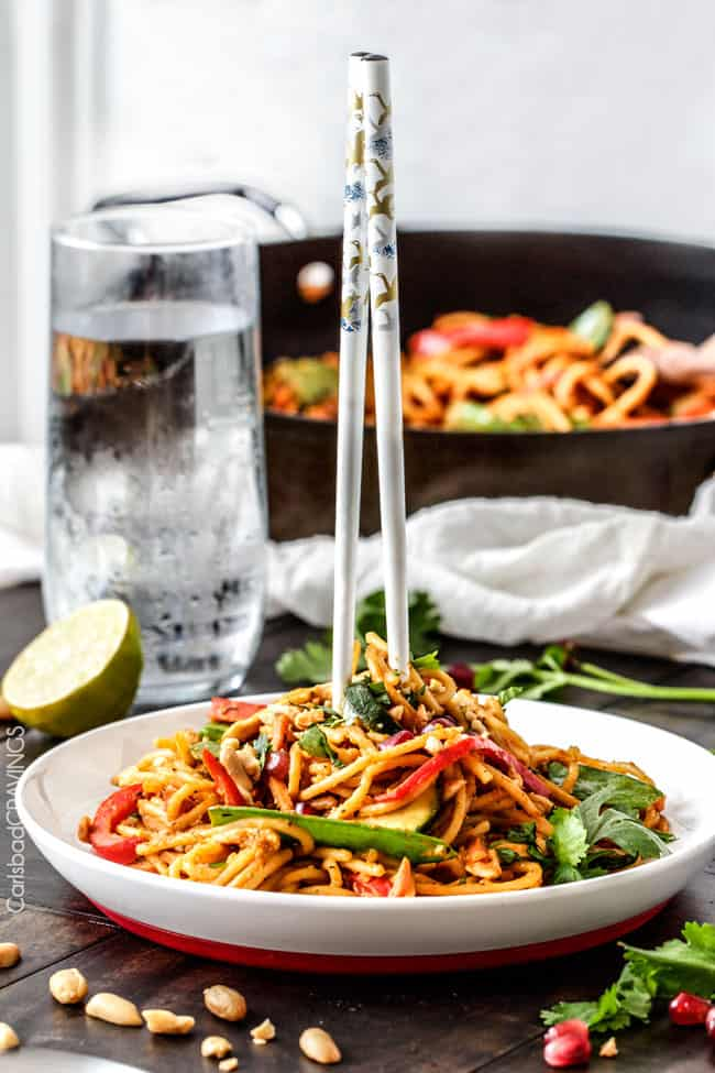 Easy 25 Minute Spicy Thai Pumpkin Noodles (with chicken option) are quick and easy to whip up and smothered in the most tantalizing spicy peanut pumpkin sauce that you will want to make year round!