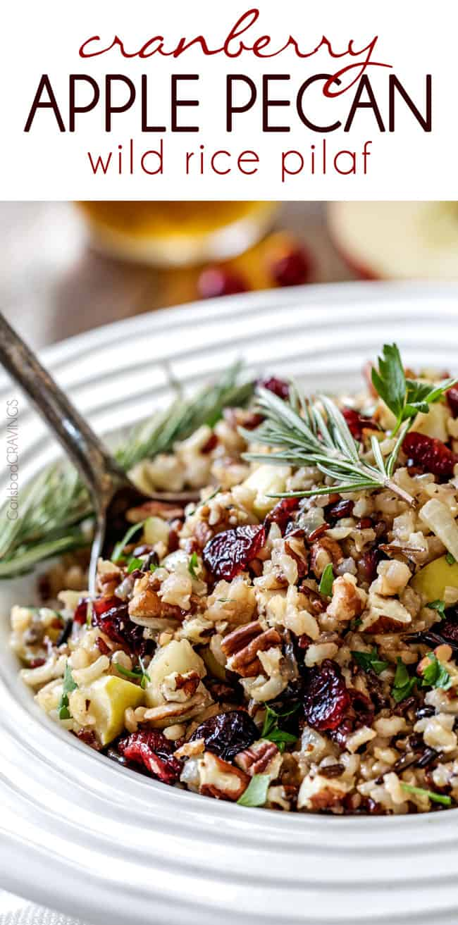 Scooping Cranberry Apple Pecan Wild Rice Pilaf simmered in herb seasoned chicken broth and apple juice and riddled with sweet dried cranberries, apples and roasted pecans.
