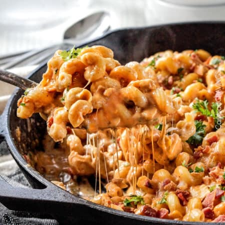Lightened Up Buffalo Bacon Chicken Macaroni and Cheese is crazy creamy without any heavy cream or butter (but with a secret ingredient instead!), less than 10 minutes prep and is so bursting with flavor you will be licking your plate!