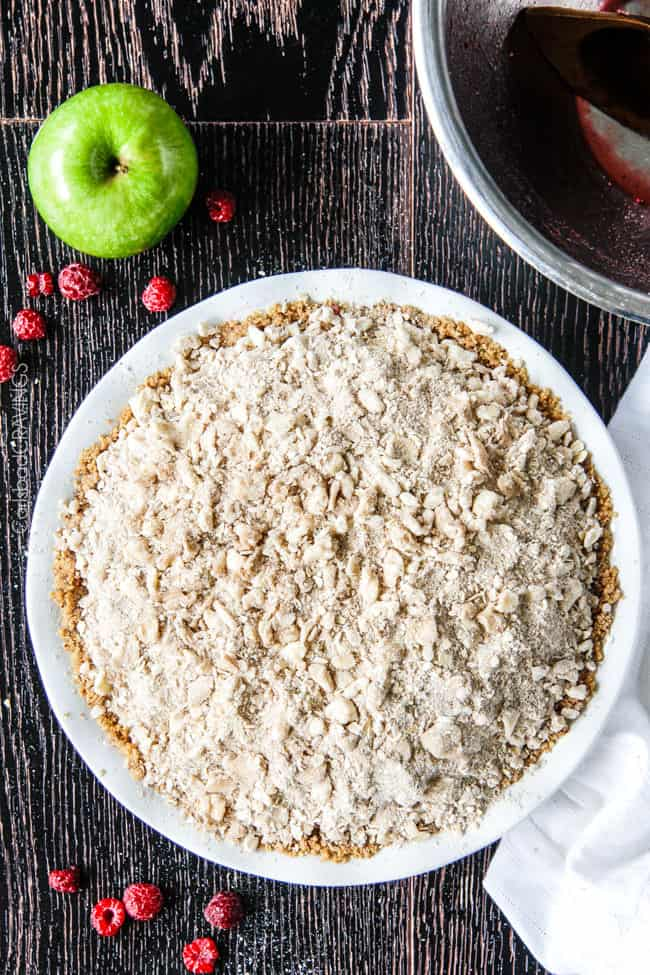 Easy Raspberry Apple Pie with Oatmeal Cookie Crumble Topping is an amazinlgy delicious twist on classic apple pie that everyone will go crazy for! I could eat the crust, filling or topping alone - every part is so good!