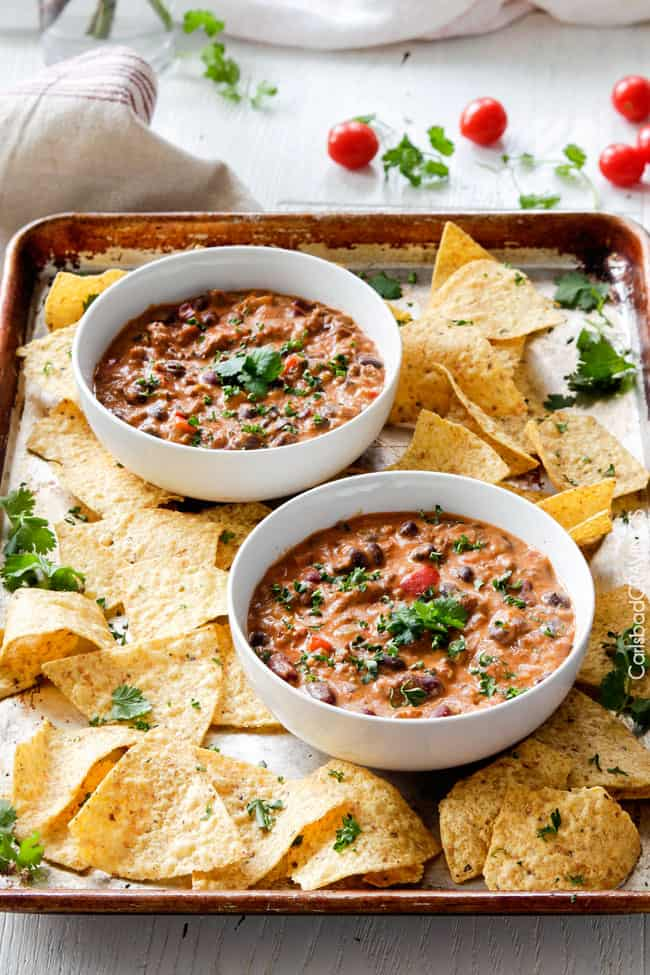 a big bowl of crockpot chili cheese dip with cream cheese surrounded by chips