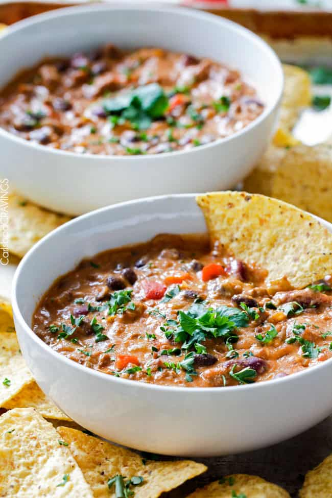 Homemade Cheesy Chili Dip or Soup is LOADED with your favorite chili ingredients, spices and SO irresistibly cheesy with NO processed cheese! Serve as a crowd pleasing appetizer or simply thin for THE most addicting soup! my favorite dip ever!