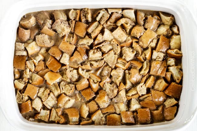 showing how to make baked french toast casserole by adding french toast cubes and egg custard to 9x13 baking dish