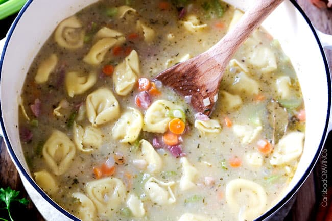hearty, cozy, Creamy Ham, White Bean Tortellini Soup simmered with onions, carrots, celery and seasonings is SO easy and lick your bowl delicious! love the addition of cheesy tortellini!