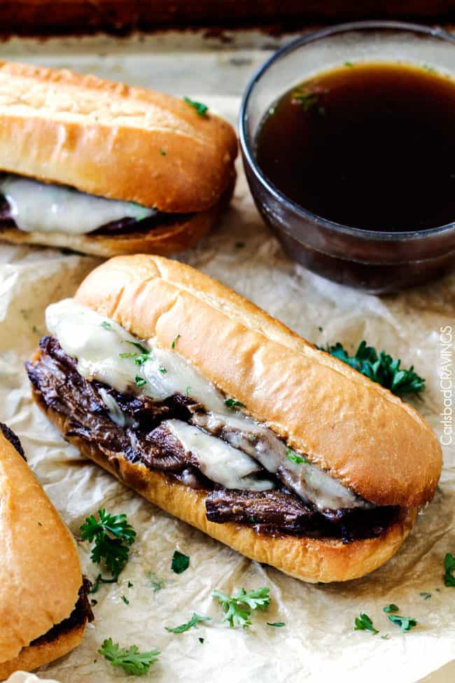 Slow Cooker French Dip Sandwiches with dipping sauce on the side.