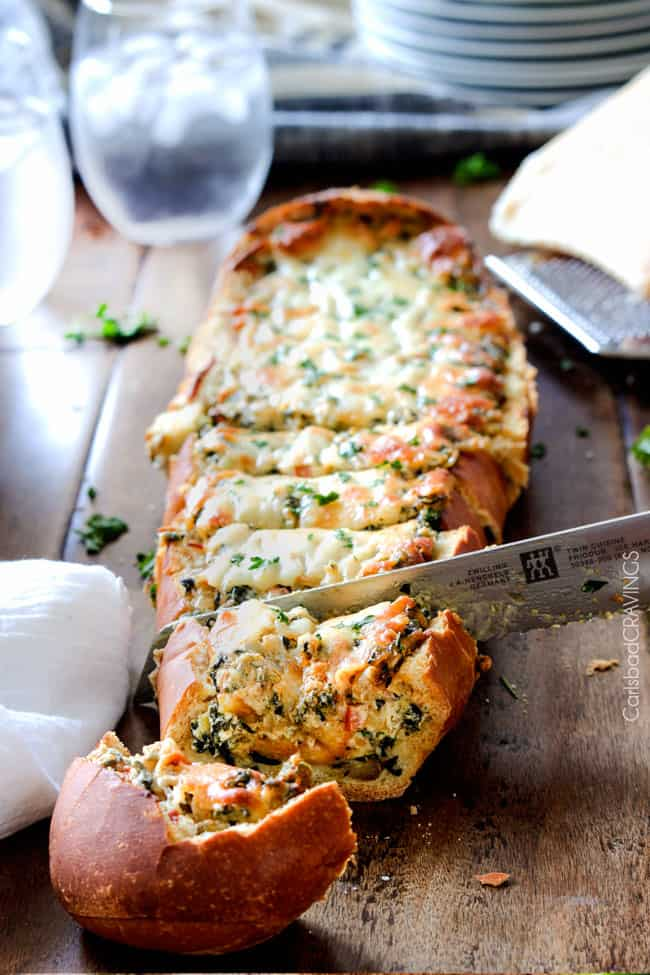 Cutting a Spinach Dip Stuffed French Bread