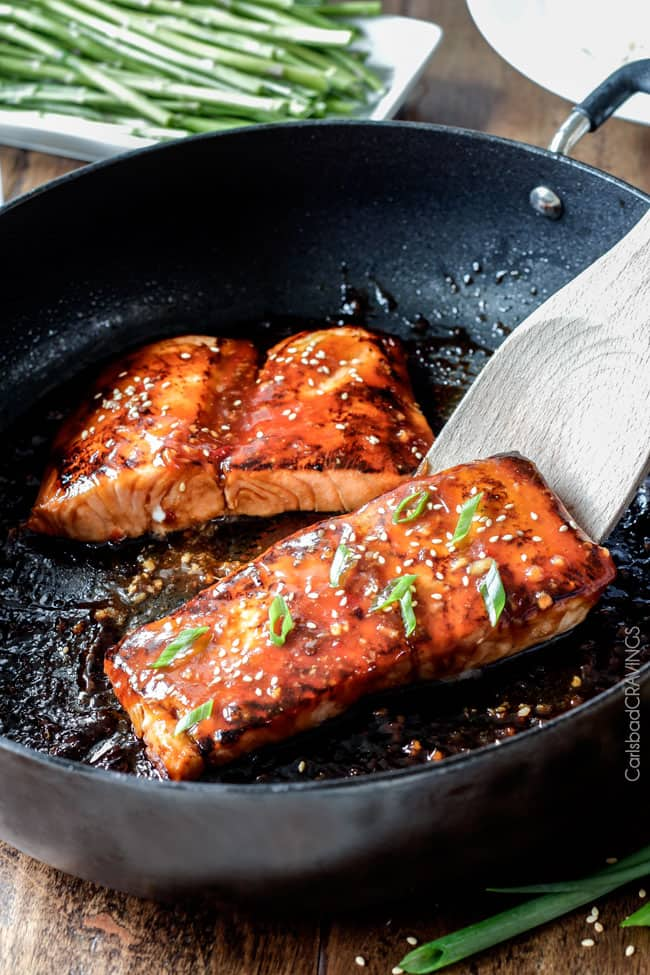 Showing how to make Asian BBQ Salmon in a pan being cooked.