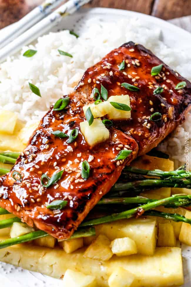 Asian BBQ Salmon on a plate with asparagus and rice.
