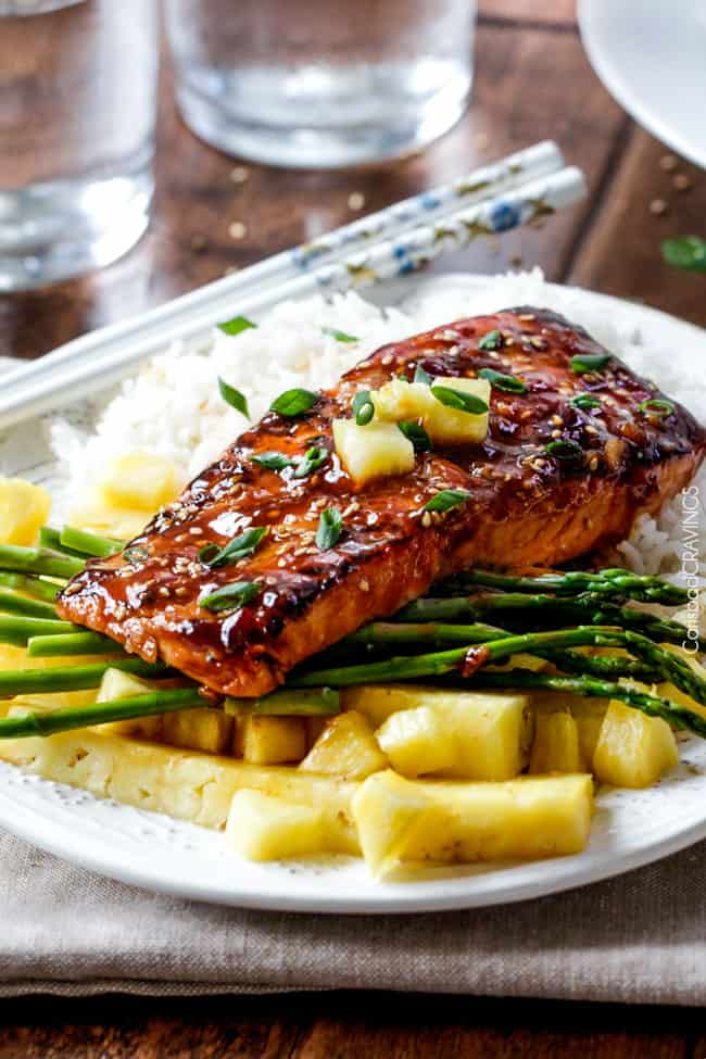 Asian BBQ Salmon on a plate with asparagus, pineapple and rice.