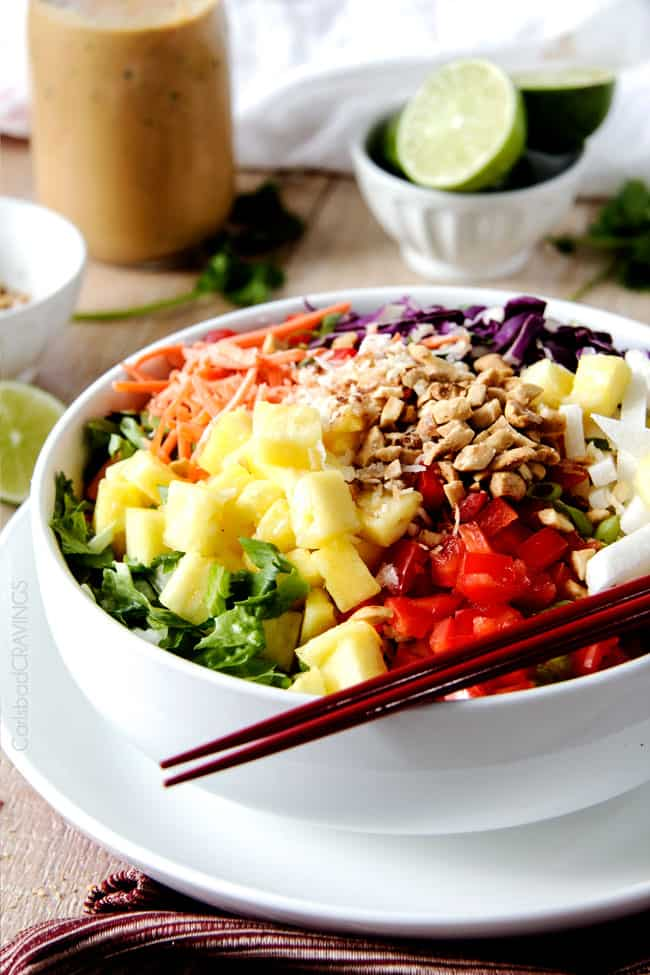Thai Peanut Salad with chop sticks in a white bowl.