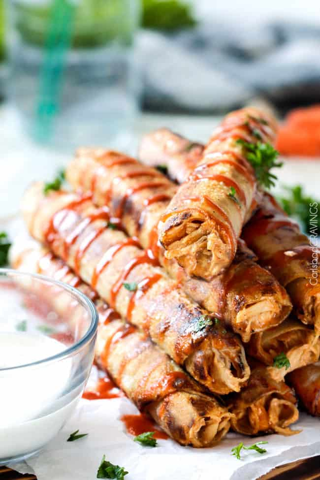 Super easy Slow Cooker Honey Buffalo Chicken Taquitos bursting with sweet heat cream cheese chicken filling you will want to eat it with a spoon! Perfect party appetizer that everyone will go crazy for or easy favorite meal!