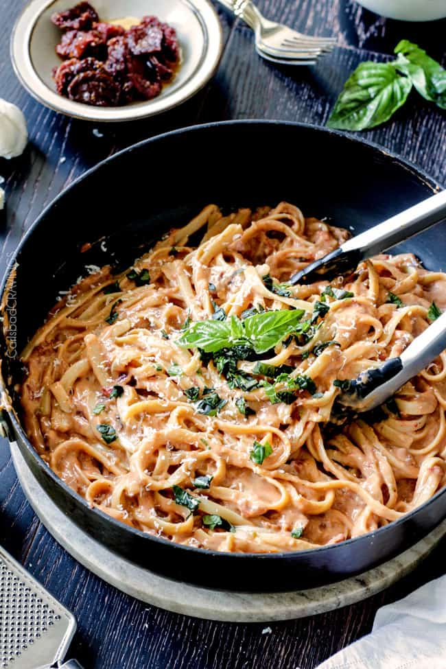 20 Minute Creamy, Lightened Up Sun-dried Tomato Fettuccine Alfredo smothered in a flavorful velvety sauce with a fraction of the calories! A great go-to dinner and totally customizable with chicken veggies, etc.