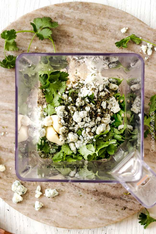 overhead view of homemade blue cheese dressing ingredients in a blender