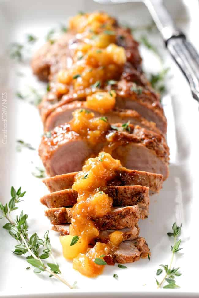 Easy, company pleasing Cajun Pork smothered in Tangy Pineapple Glaze is sweet and spicy and melt in your mouth tender! The layers of flavor or out of this world!