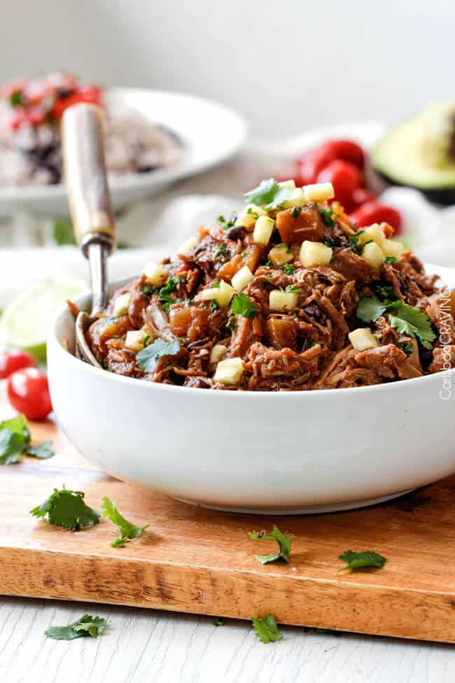 Slow Cooker Sweet and Spicy (optional) Pineapple Salsa Pork - crazy good EASY, flavorful filling for burritos, tacos, burrito bowls, salads, etc. I love making this for company because its SO good and SO easy!