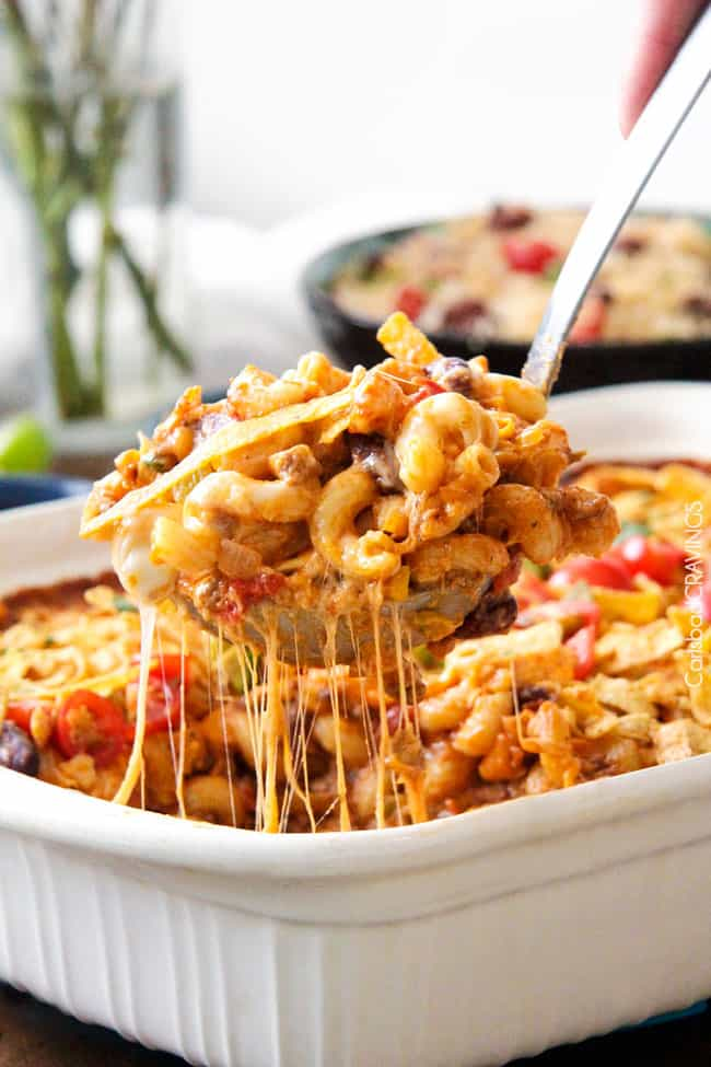 LIGHTER Cheesy Taco Pasta is my husband's absolute favorite pasta! Juicy beef, beans, pasta etc., smothered in an incredible Mexican spiced sauce is out of this world delicious! Your whole family will LOVE this and its super easy!