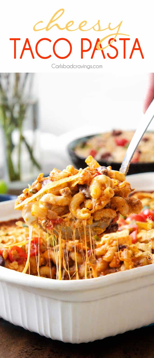 a serving of taco pasta casserole being lifted from a baking dish.