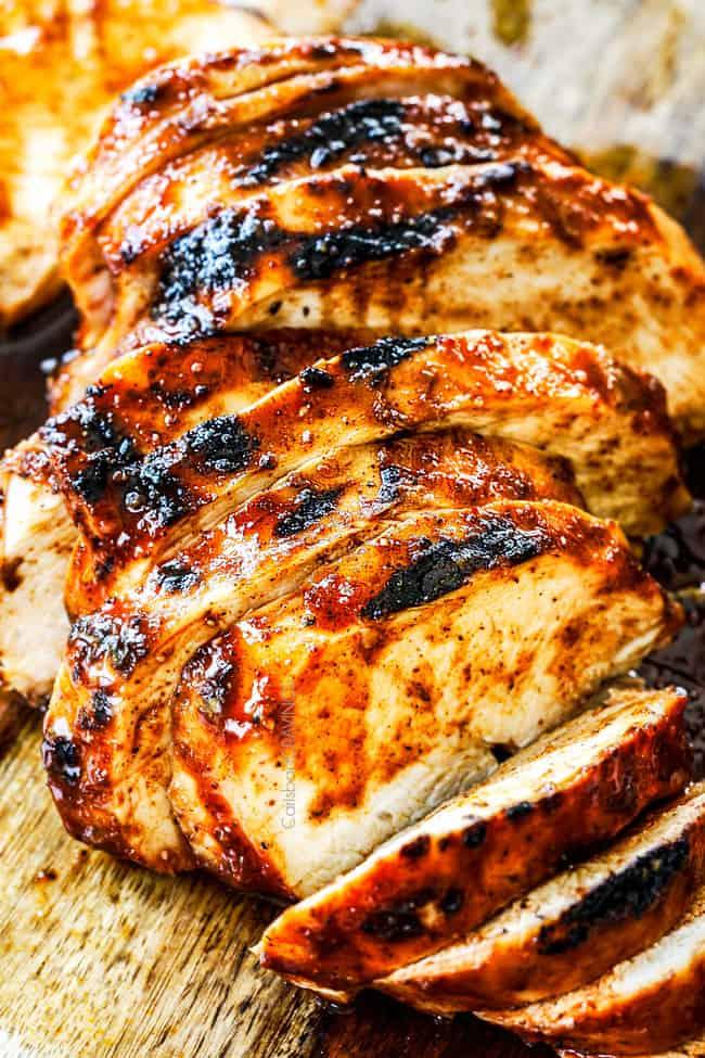 sliced easy buffalo chicken on a wood cutting board