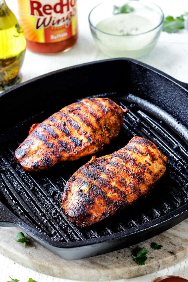 Showing How to Make Buffalo Chicken Recipe by grilling chicken on indoor grill pan